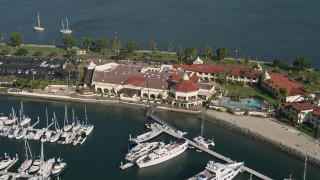 DCA08_175 - 4K stock footage aerial video of a reverse view of an oceanfront hotel, Shelter Island, California