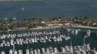 DCA08_176 - 4K stock footage aerial video of a reverse view of an oceanside hotel and marina, Shelter Island, California
