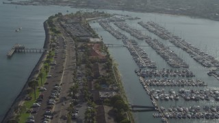DCA08_177 - 4K stock footage aerial video orbit marina and tilt to reveal island hotel, Shelter Island, California
