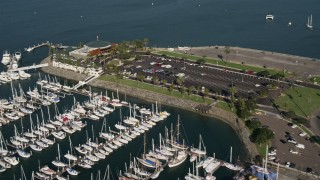 DCA08_179 - 4K stock footage aerial video fly over an oceanfront restaurant, Shelter Island, California