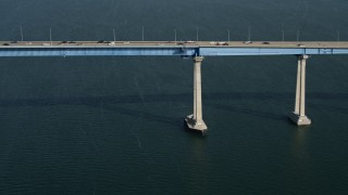 DCA08_183 - 4K stock footage aerial video tilt from sailboat to reveal the Coronado Bridge, San Diego, California