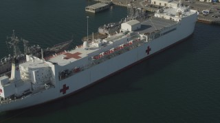 DCA08_185 - 4K stock footage aerial video orbit Red Cross hospital ship at shipyard, San Diego, California