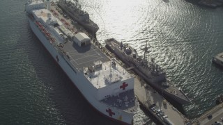 DCA08_186 - 4K stock footage aerial video orbit docked Red Cross hospital ship, San Diego, California