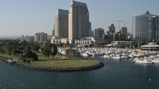 DCA08_194 - 4K stock footage aerial video of low altitude flyby of waterfront hotels and marina, Downtown San Diego, California