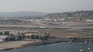 DCA08_198 - 4K stock footage aerial video of tracking a landing passenger jet, San Diego International Airport, California