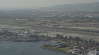 DCA08_200 - 4K stock footage aerial video of tracking a cargo plane landing at San Diego International Airport, California
