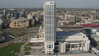 DCA08_202 - 4K stock footage aerial video flyby a waterfront hotel in Downtown San Diego, California
