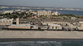 DCA08_209 - 4K stock footage aerial video orbit a beachside military base, Naval Amphibious Base, Coronado, California