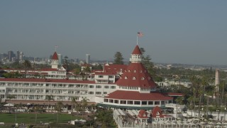 DCA08_211 - 4K stock footage aerial video orbit historic oceanfront hotel, the Hotel del Coronado, in California