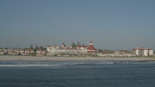 DCA08_213 - 4K stock footage aerial video orbit and fly away from oceanfront Hotel del Coronado, California