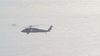DCA08_215 - 4K stock footage aerial video track military helicopter near Naval Air Station North Island, California