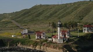 DCA08_219 - 4K stock footage aerial video orbit an oceanside lighthouse, Point Loma, California