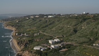 DCA08_223 - 4K stock footage aerial video of a satellite dish and scientific facility on coastal cliffs, Point Loma, California