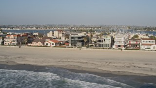 DCA08_233 - 4K stock footage aerial video of flying by beachfront condominiums, Mission Beach, California