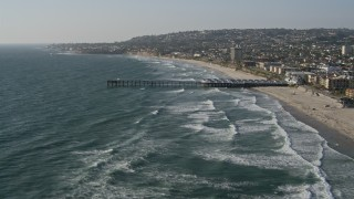 DCA08_235 - 4K stock footage aerial video of flying over a pier by coastal neighborhoods, Pacific Beach, California