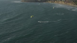 DCA08_237 - 4K stock footage aerial video approach and orbit kite surfers, Pacific Beach, California