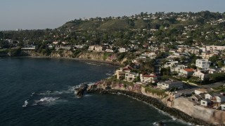 DCA08_240 - 4K stock footage aerial video pan across upscale, oceanfront homes and cliffs, La Jolla, California