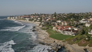 DCA08_243 - 4K stock footage aerial video of flying by upscale homes in an oceanfront neighborhood, La Jolla, California