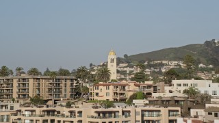 DCA08_244 - 4K stock footage aerial video flyby beachfront condos and focus on a church steeple, La Jolla, California