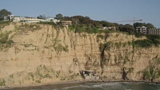 DCA08_250 - 4K stock footage aerial video tilt to reveal clifftop homes with ocean views, La Jolla, California