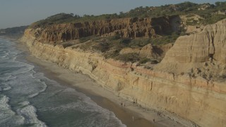 DCA08_257 - 4K stock footage aerial video of panning across coastal cliffs and beach, La Jolla, California