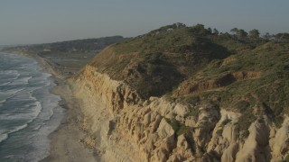 DCA08_258 - 4K stock footage aerial video of panning across coastal cliffs in La Jolla, California
