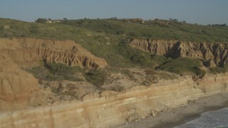 DCA08_259 - 4K stock footage aerial video fly over coastal cliffs to reveal a golf course, La Jolla, California
