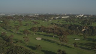DCA08_260 - 4K stock footage aerial video of flying over and panning across a gold course, La Jolla ,California