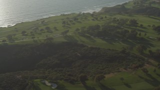 DCA08_261 - 4K stock footage aerial video orbit golf courses atop cliffs in La Jolla, California