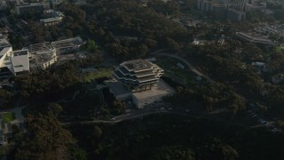 DCA08_262 - 4K stock footage aerial video orbit a campus library, University of California, San Diego, California