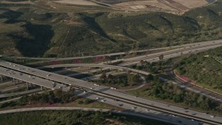 DCA08_266 - 4K stock footage aerial video of light traffic on a freeway interchange, San Diego, California