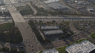 DCA08_268 - 4K stock footage aerial video of light freeway traffic and overpass, San Diego, California