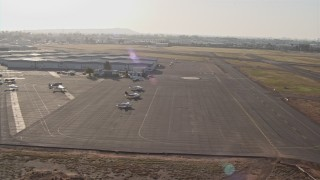 DCA08_269 - 4K stock footage aerial video approach a small airfield for landing, Montgomery Field, California
