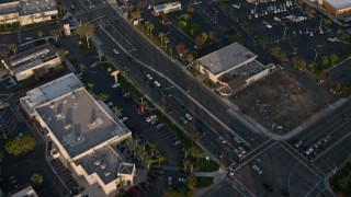 DCA08_272 - 4K stock footage aerial video of a reverse view of strip malls, and reveal suburban houses, Clairemont, California, Sunset
