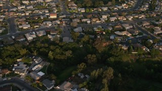 DCA08_273 - 4K stock footage aerial video of a reverse view of suburban tract homes in Clairemont, California, Sunset