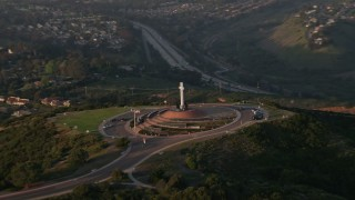 DCA08_277 - 4K stock footage aerial video orbit the Soledad Cross monument in La Jolla, California, Sunset