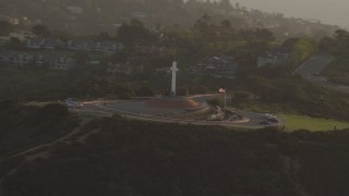 DCA08_278 - 4K stock footage aerial video orbit the Soledad Cross religious monument in La Jolla, California, Sunset