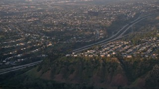 DCA08_281 - 4K aerial stock footage video of suburban neighborhoods and freeway, La Jolla ,California, Sunset