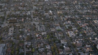 DCA08_284 - 4K stock footage aerial video reverse and pan across suburban houses and apartment buildings, Pacific Beach, California, Sunset
