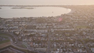 DCA08_286 - 4K stock footage aerial video of bayside suburban houses and park, Pacific Beach, California, Sunset