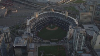 DCA08_294 - 4K stock footage aerial video approach and orbit a baseball stadium in Downtown San Diego, California, Sunset