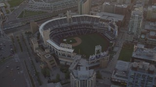 DCA08_295 - 4K stock footage aerial video orbit of a baseball stadium in Downtown San Diego, California, Sunset