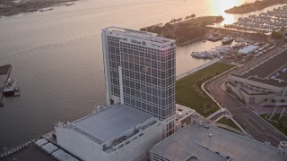 DCA08_299 - 4K aerial stock footage video of a bayside hotel in Downtown San Diego, California, at sunset