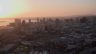 DCA08_301 - 4K stock footage aerial video approach skyscrapers in Downtown San Diego, California, Sunset