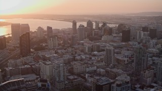 DCA08_302 - 4K stock footage aerial video approach skyscrapers at sunset in Downtown San Diego, California