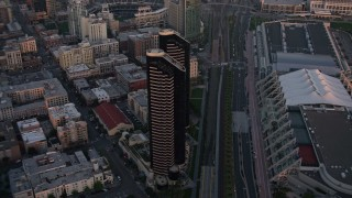 DCA08_309 - 4K stock footage aerial video of a condominium skyscraper complex in Downtown San Diego, California, Sunset