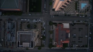 DCA08_311 - 4K stock footage aerial video of a bird's eye of city streets, skyscrapers, and a shopping mall; Downtown San Diego, California, Sunset