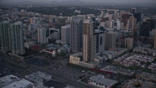 DCA08_322 - 4K stock footage aerial video of panning past city skyscrapers and streets in Downtown San Diego, California, Sunset