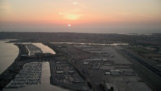 DCA08_327 - 4K stock footage aerial video of the setting sun over San Diego International Airport, California