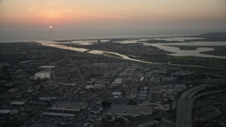 DCA08_329 - 4K stock footage aerial video pan across suburban houses, bay and SeaWorld theme park to the university, San Diego, California, Sunset